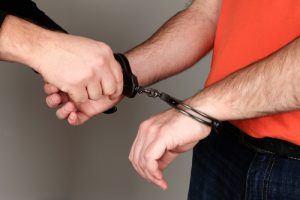 bail bond company man in handcuffs