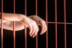 bonds person behind bars
