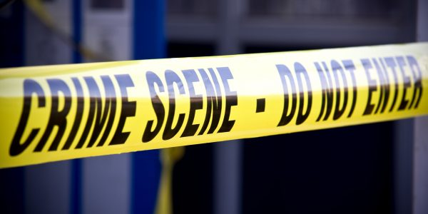 """Houston murder bonds - yellow """"CRIME SCENE - DO NOT ENTER"""" tape at the scene of a murder."""
